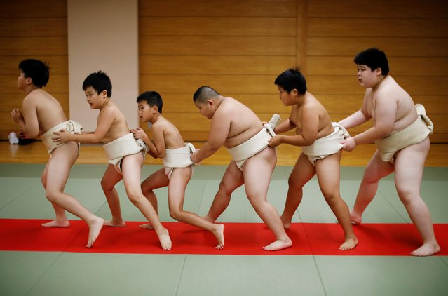 """Kyuta Kumagai, 10, warms up with other boys before training, at Komatsuryu sumo club in Tokyo, Japan, August 23, 2020. """"It is fun to beat people older than me"""", said Kyuta. (Photo by Kim Kyung-Hoon/Reuters)"""