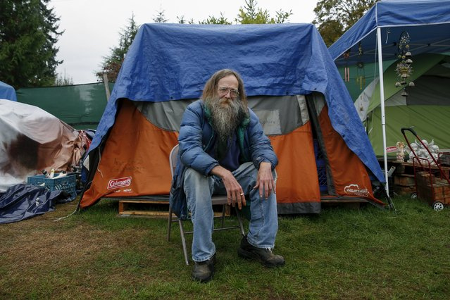 Lantz Rowland, 59 poses in front of his tent at SHARE/WHEEL Tent City 3 outside Seattle, Washington October 8, 2015. (Photo by Shannon Stapleton/Reuters)