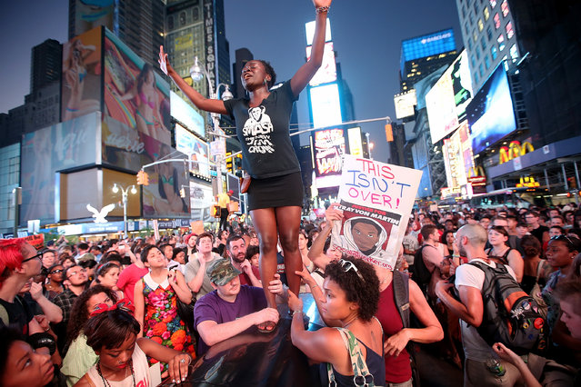 Trayvon Martin supporters rally in New York City's Times Square after marching from a rally in Union Square July 14, 2013. The action came after George Zimmerman was acquitted July 13 of all charges in the February 2012 shooting death of Martin. (Photo by Mario Tama/Getty Images)