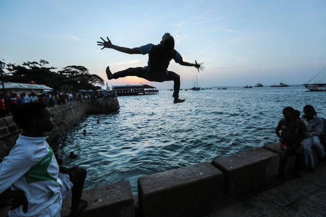 Zanzibari youth jump into the Indian Ocean from Forodhani Gardens park in the historical city of Stone Town, Zanzibar, Tanzania, on Wednesday, January 21, 2015. (Photo by Mosa'ab Elshamy/AP Photo)