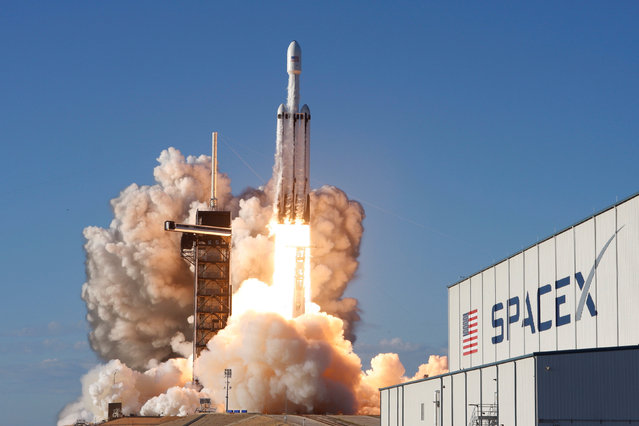 A SpaceX Falcon Heavy rocket, carrying the Arabsat 6A communications satellite, lifts off from the Kennedy Space Center in Cape Canaveral, Florida, U.S., April 11, 2019. (Photo by Thom Baur/Reuters)