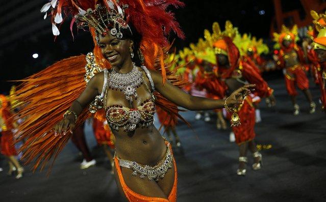 A reveller from the Unidos de Bangu samba school  takes part in the Group A category of the annual Carnival parade in Rio de Janeiro's Sambadrome, February 13, 2015. (Photo by Ricardo Moraes/Reuters)