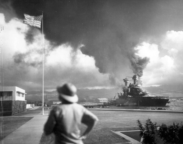 The damaged battleship USS California, listing to port after being hit by Japanese aerial torpedoes and bombs, is seen off Ford Island during the attack on Pearl Harbor, Hawaii, U.S. December 7, 1941. (Photo by Reuters/U.S. Navy/National Archives)