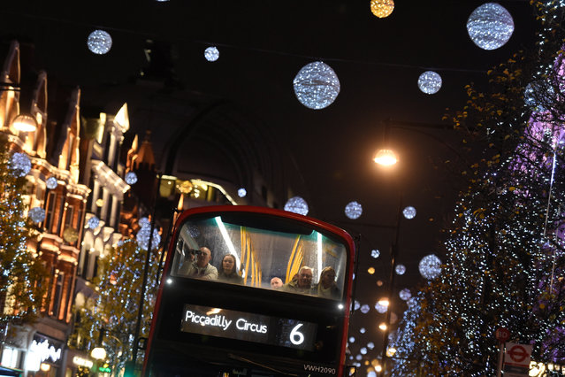 People are seen on a London bus travelling on Oxford Street past Christmas lights in London, Britain, December 9, 2016. (Photo by Clodagh Kilcoyne/Reuters)
