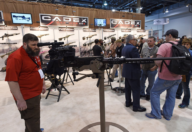 John Correia poses with a .50 caliber M2 machine gun equipped with a SOLO sight mount by Cadex at the 2016 National Shooting Sports Foundation's Shooting, Hunting, Outdoor Trade (SHOT) Show at the Sands Expo and Convention Center on January 19, 2016 in Las Vegas, Nevada. (Photo by Ethan Miller/Getty Images)