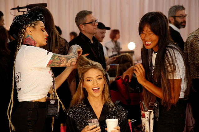 Model Martha Hunt is prepped backstage during the Victoria's Secret fashion show in the Manhattan borough of New York City, U.S., November 8, 2018. (Photo by Caitlin Ochs/Reuters)