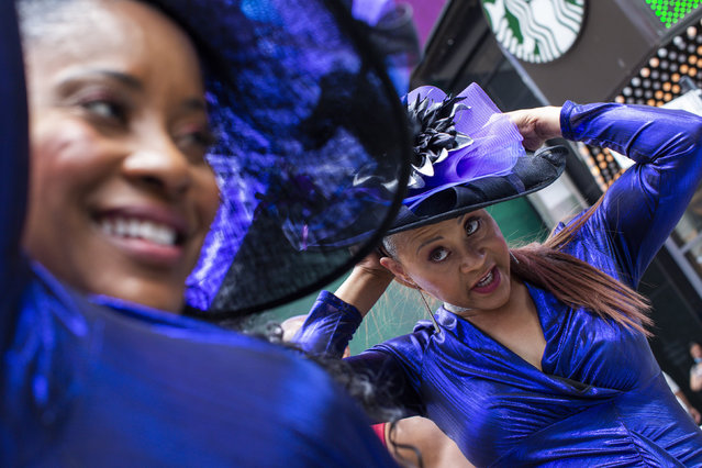 Women wait to perform during a free outdoor event organized by The Broadway League during Juneteenth celebrations at Times Square on Saturday, June 19, 2021, in New York. Parades, picnics and lessons in history marked Juneteenth celebrations in the U.S., a day that marks the arrival of news to enslaved Black people in a Texas town that the Confederacy had surrendered in 1865 and they were free. (Photo by Eduardo Munoz Alvarez/AP Photo)
