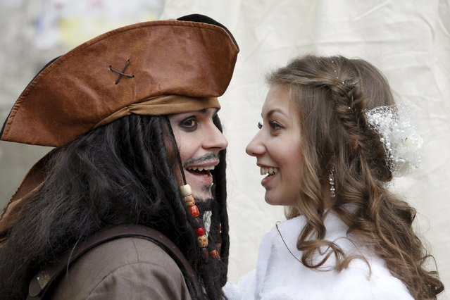 German Yesakov, 25, a cameraman from Russia, dressed as movie character Captain Jack Sparrow, and his bride Anastasiya smile during their wedding ceremony in the southern city of Stavropol, Russia, February 5, 2016. (Photo by Eduard Korniyenko/Reuters)