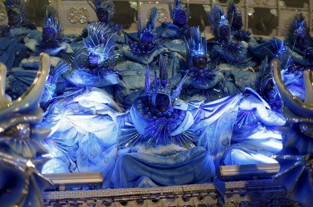 Revellers of Portela samba school perform during the carnival parade at the Sambadrome in Rio de Janeiro, February 9, 2016. (Photo by Pilar Olivares/Reuters)