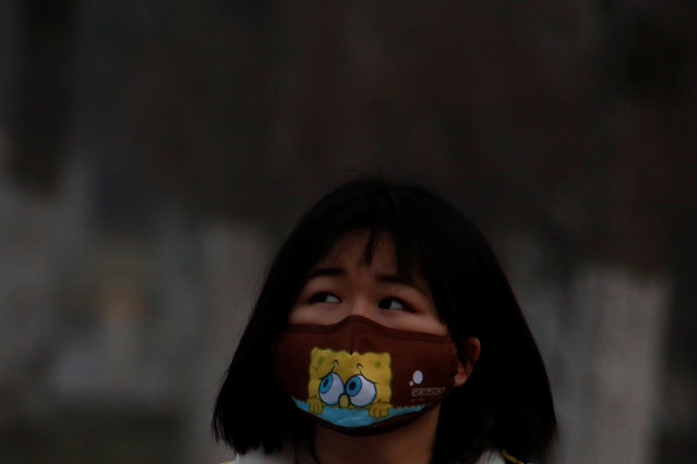 A woman wears a face mask on a polluted day in Beijing, China, January 3, 2017. (Photo by Thomas Peter/Reuters)