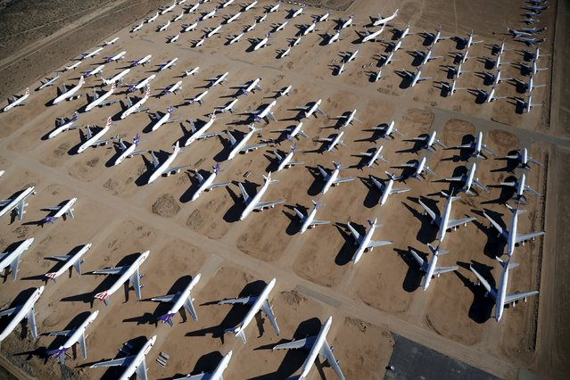 Old airplanes, including Boeing 747-400s, are stored in the desert in Victorville, California March 13, 2015. (Photo by Lucy Nicholson/Reuters)