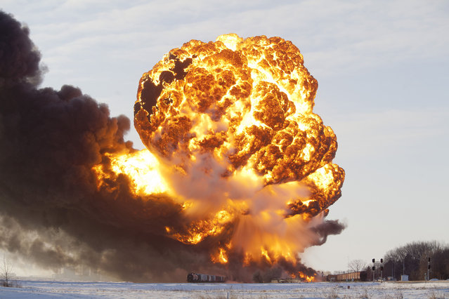 A massive fireball from an exploding train car rises into the air just west of Casselton, on December 30, 2013. The freight train was carrying 110 cars and went off the tracks west of Casselton and was hit by a second train. There were no reports of injuries from the accident. (Photo by Dave Arntson/ZUMA Press)