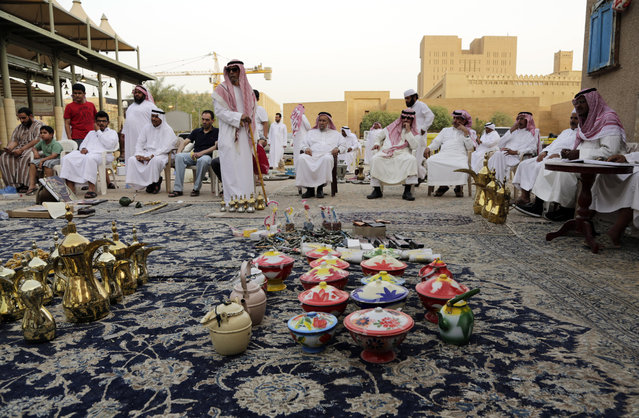 In this April 16, 2015 photo, traditional coffee pots, left, and colorful clay dishes are on display at al-Aqeeliya open-air auction market in Riyadh, Saudi Arabia. (Photo by Hasan Jamali/AP Photo)