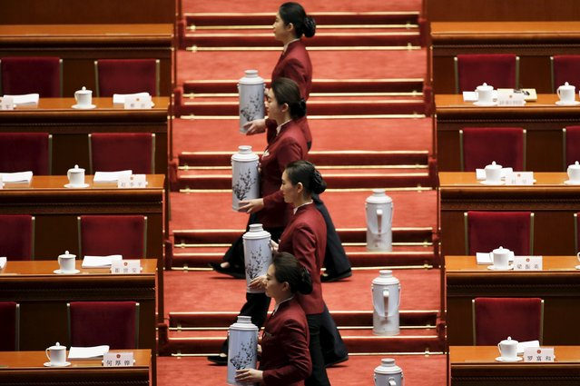 Attendants serve tea as they prepare for the opening session of the National People's Congress (NPC) in Beijing, China, March 5, 2016. (Photo by Jason Lee/Reuters)