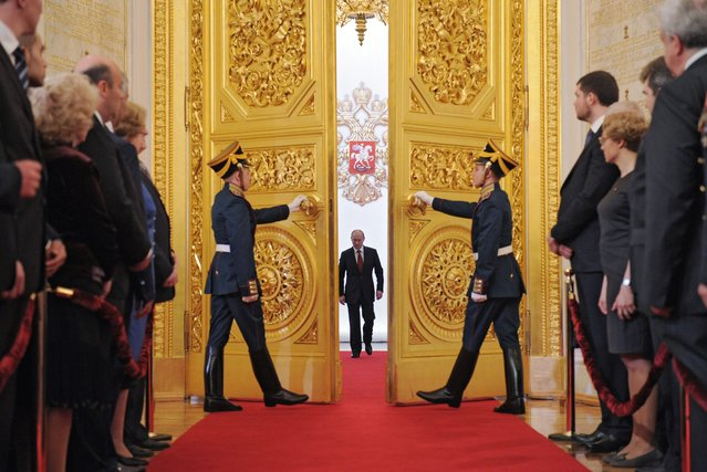 Russia's President Vladimir Putin (C) enters Andreyevsky (St. Andrew's) Hall at the Great Kremlin Palace in Moscow's Kremlin, on May 7, 2012, during his inauguration ceremony. (Photo by Alexey Druzhinin/AFP Photo/RIA Novosti)