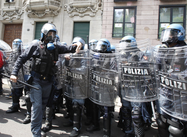 Police in riot gear advance during a protest against Expo 2015 in Milan, Italy, Thursday, April 30, 2015. (Photo by Antonio Calanni/AP Photo)