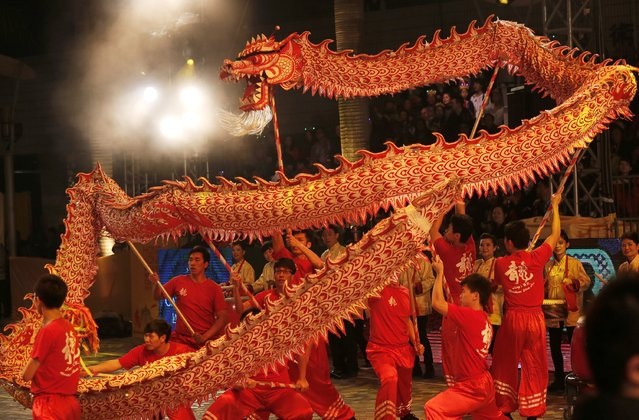 Performers show dragon dance during a night parade to celebrate Chinese New Year in Hong Kong, Friday, January 31, 2014. (Photo by Vincent Yu/AP Photo)