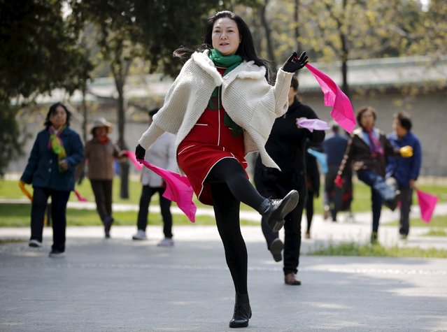 Women perform square dancing at a park square in Beijing, China, April 13, 2015. (Photo by Kim Kyung-Hoon/Reuters)