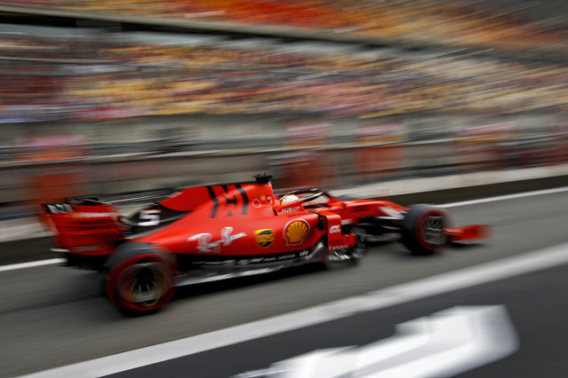 Ferrari driver Sebastian Vettel of Germany steers his car during the second practice session for the Chinese Formula One Grand Prix at the Shanghai International Circuit in Shanghai, China, Friday, April 12, 2019. (Photo by Andy Wong/AP Photo)
