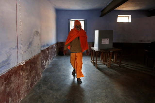 A Sadhu or a Hindu holy man leaves after casting his vote at a polling booth during the state assembly election in Garhmukteshwar, in the central state of Uttar Pradesh, India, February11, 2017. (Photo by Adnan Abidi/Reuters)