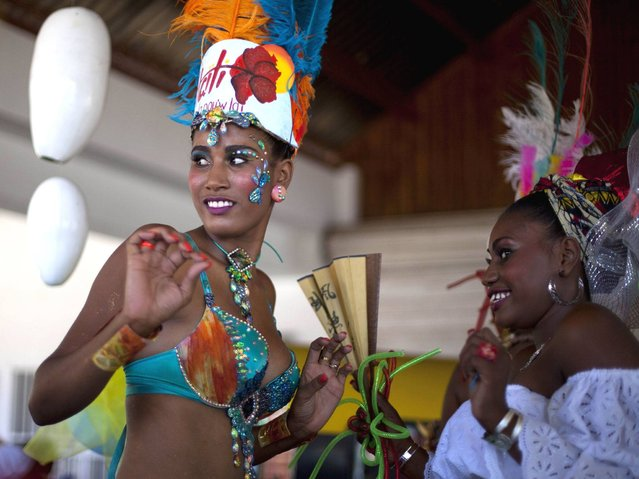 Carnival Queen Fabienne Francois dances at Carnival celebrations in Jacmel, Haiti, Sunday, February 23, 2014. The Carnival spirit took hold as Jacmel's annual parade snaked through the downtown of this coastal town revered among Haitians for its artists and artisans. (Photo by Dieu Nalio Chery/AP Photo)