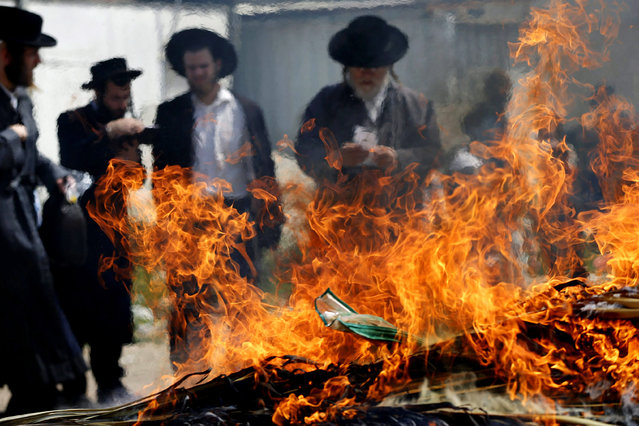 Ultra-Orthodox Jewish men burn leaven in the Mea Shearim neighbourhood of Jerusalem, ahead of the Jewish holiday of Passover, April 3, 2015. Passover commemorates the flight of Jews from ancient Egypt, as described in the Exodus chapter of the Bible. According to the account, the Jews did not have time to prepare leavened bread before fleeing to the promised land. (Photo by Ammar Awad/Reuters)