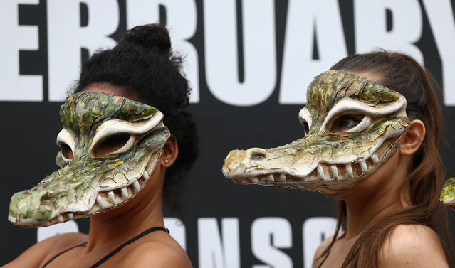 Peta models in crocodile masks protest against the use of crocodile skins in fashion during London Fashion Week in London, Britain February 17, 2017. (Photo by Neil Hall/Reuters)