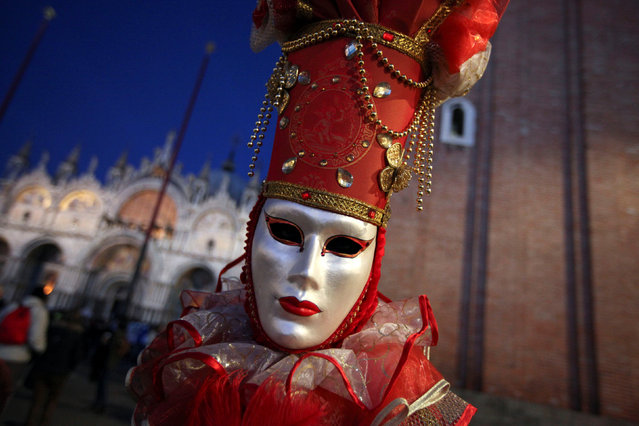 Masked reveller poses during the Venice Carnival in Venice, Italy February 18, 2017. (Photo by Fabrizio Bensch/Reuters)