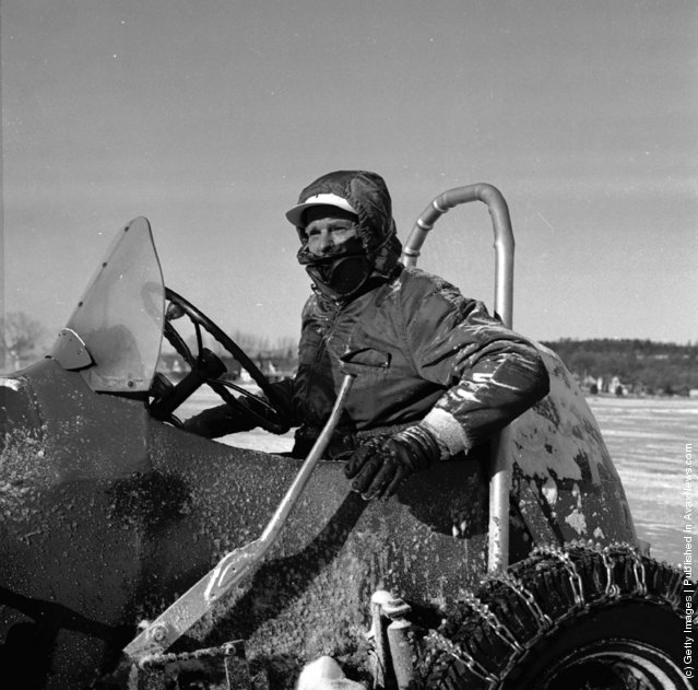 1955: With chains fitted properly on the wheels, the driver is just about ready to race his midget car on the ice at Lily Pond