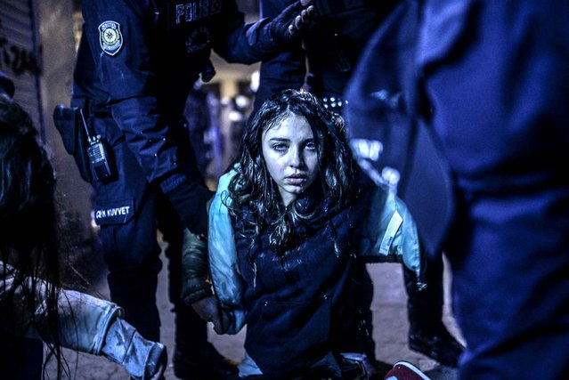A young girl is pictured after she was wounded during clashes between riot-police and prostestors after the funeral of Berkin Elvan, the 15-year-old boy who died from injuries suffered during last year's anti-government protests, in Istanbul on March 12, 2014. Riot police fired tear gas and water cannon at protestors in the capital Ankara, while in Istbanbul, crowds shouting anti-government slogans lit a huge fire as they made their way to a cemetery for the burial of Berkin Elvan. (Photo by Bulent Kilic/AFP Photo)