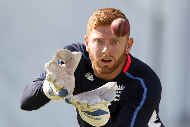 In this Saturday, February 2, 2019 file photo, England's wicket keeper Jonny Bairstow warms up prior to the start of day three of the second Test cricket match against West Indies at the Sir Vivian Richards Stadium in North Sound, Antigua and Barbuda. The 2019 Cricket World Cup starts in England on May 31. (Photo by Ricardo Mazalan/AP Photo/File)