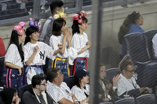 Members of the Japanese pop group Momoiro Clover Z dance before the start of the seventh inning of a baseball game between the New York Yankees and the San Diego Padres, Tuesday, May 28, 2019, in New York. New York Yankees starting pitcher Masahiro Tanaka has walked out to music from the four-woman idol group since coming to the Major League in 2014. (Photo by Julio Cortez/AP Photo)