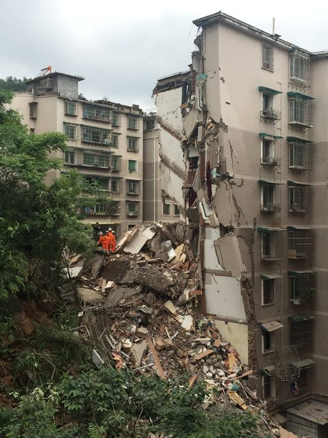 Rescue workers search amongst the rubble of a collapsed nine-storey residential building in Guiyang, Guizhou province, China, May 20, 2015. According to Xinhua News Agency, at the time of the collapse, there were people inside the building and that the number of casualties are unknown. (Photo by Reuters/China Daily)