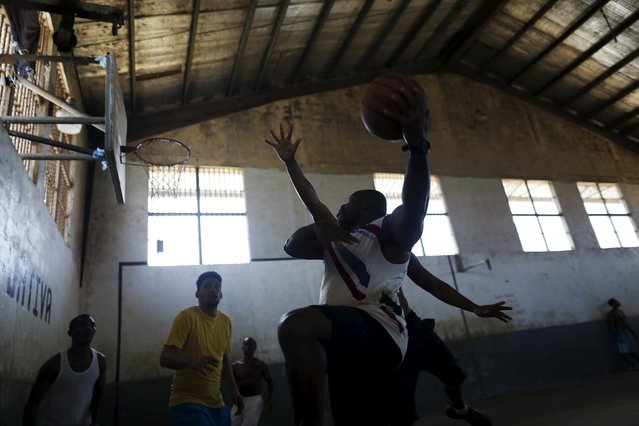Inmates play basketball at the Pavilion No.6 assigned to foreigners at La Joya prison on the outskirts of Panama City, Panama January 29, 2016. (Photo by Carlos Jasso/Reuters)