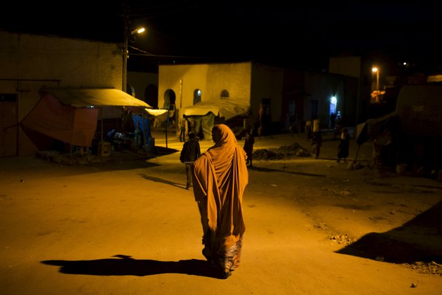 A woman walks in the old walled town of Harar in eastern Ethiopia, May 20, 2015. (Photo by Siegfried Modola/Reuters)