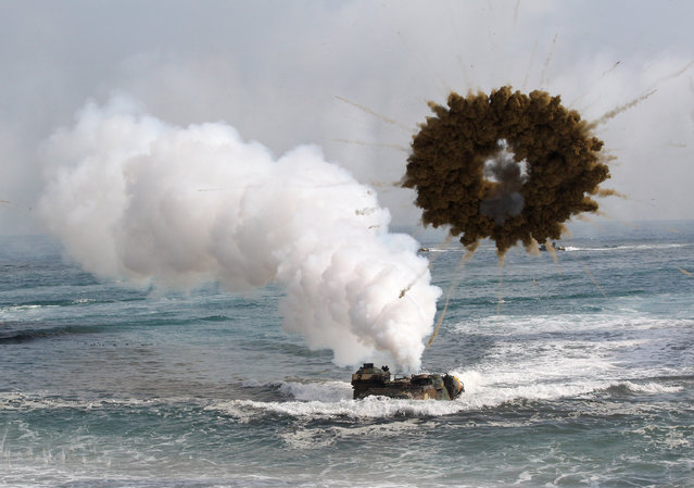 A South Korean marine LVT-7 landing craft sail to shores through a smoke screen during the U.S.-South Korea joint landing exercises called Ssangyong, part of the Foal Eagle military exercises, in Pohang, South Korea, Monday, March 31, 2014. South Korea said North Korea has announced plans to conduct live-fire drills near the rivals' disputed western sea boundary. (Photo by Ahn Young-joon/AP Photo)