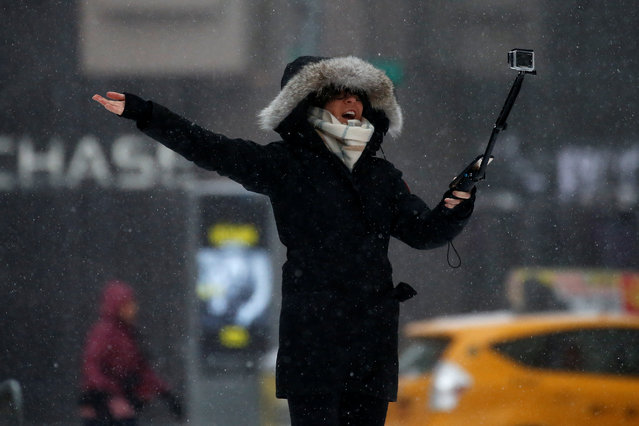 A woman takes a selfie in Times Square during a snow storm in Manhattan, New York, U.S., March 14, 2017. (Photo by Carlo Allegri/Reuters)