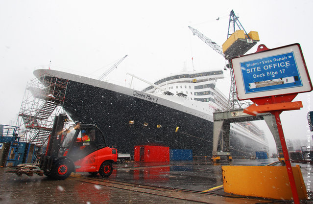The 'Queen Mary 2' cruise ship lies at the Blohm & Voss Repair shipyard after a 10-day intense renovation