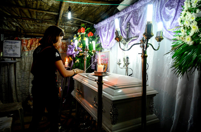 The mother views the coffin of her 3 year old baby Kateleen Myca Ulpina, killed during a sting operation conducted by the police, is seen during her wake in Rodriguez, Rizal, east of Manila on July 5, 2019. A Philippine senator who initially led President Rodrigo Duterte's deadly drug war sparked outrage when he dismissed the killing of a toddler in a police anti-narcotics operation with an expletive and as collateral damage. (Photo by Noel Celis/AFP Photo)