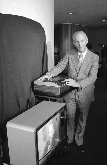 Roy H. Pollack, vice president and general manager of RCA Corporation consumer electronics, demonstrates a new video tape machine Introduced in New York, August 23, 1977. The recorder, intended for home use, will be priced at $1,000, and will be capable of handling cassettes that can record up to four hours of television programs. Cassettes now available record up to two hours. (Photo by AP Photo)