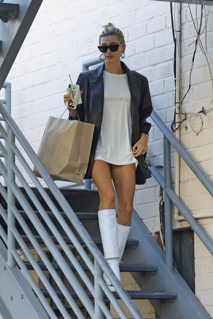 Hailey Bieber is dressed to impress leaving a business meeting in Beverly Hills, CA. on September 17, 2019 wearing black and white leather with knee-high boots and a shirtdress. (Photo by Backgrid USA)