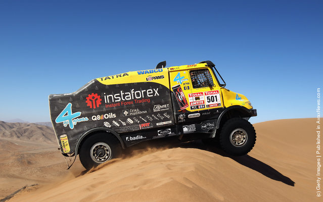 Alex Loprais of the Czech Republic drives his Tatra truck over a sand dune during stage seven of the 2012 Dakar Rally