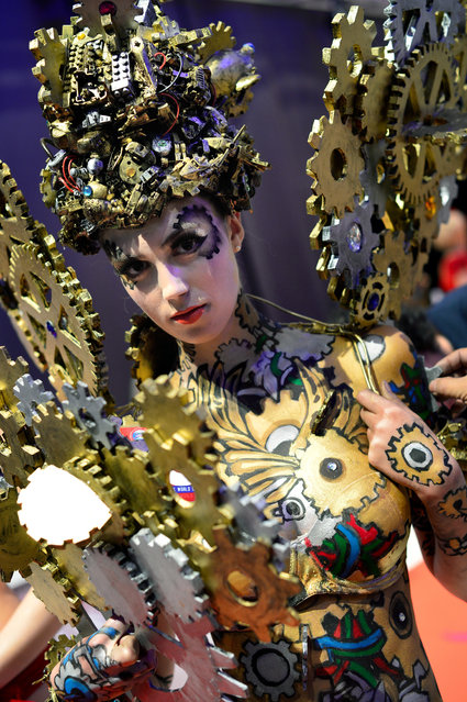 "A model poses after the contest ""Body Painting"" of the OMC Hairworld World Cup on May 4, 2014 in Frankfurt am Main, Germany. The OMC Hairworld World Cup will be held in Frankfurt from 3 to 5 May 2014, parallel to the Hair and Beauty 2014 fair. Around 1.250 participants from 50 countries fight in different contest for the titles. (Photo by Thomas Lohnes/Getty Images)"