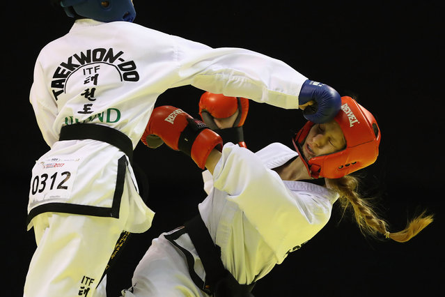 Anna Skuratova (R) of Ukraine receives a blow from Sofia Hu (L) of Ireland in the Individual Sparring Junior 14-15 Female 52 kg category during day two of the 2017 European Taekwondo Championships at The Echo Arena on April 28, 2017 in Liverpool, England. (Photo by Michael Steele/Getty Images)