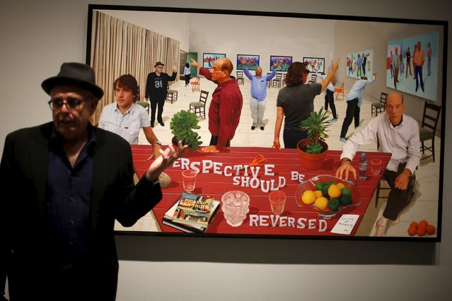 """A man stands in front of a photographic drawing he appears in called """"Perspective Should be Reversed"""", by British artist David Hockney at a preview of Hockney's exhibition """"Painting and Photography"""" at the L.A. Louver gallery in Venice, Los Angeles, California, United States July 15, 2015. (Photo by Lucy Nicholson/Reuters)"""