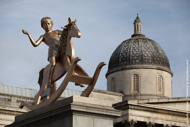 A sculpture entitled 'Powerless Structures, Fig.101' designed by Danish artist Michael Elmgreen and Norwegian artist Ingar Dragset is unveiled on the Fourth Plinth in Trafalgar Square