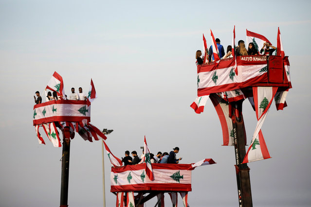 People attend a parade, on the 76th anniversary of Lebanon's independence, from a crane platform at Martyrs' Square in Beirut, Lebanon on November 22, 2019. (Photo by Andres Martinez Casares/Reuters)
