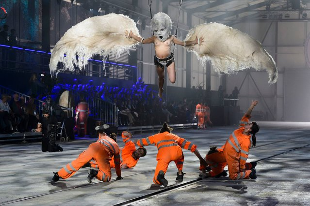Artists perform during a show on the opening day of the Gotthard rail tunnel at the fairground Rynaecht at the northern portal in Erstfeld, Switzerland, on June 1, 2016. 