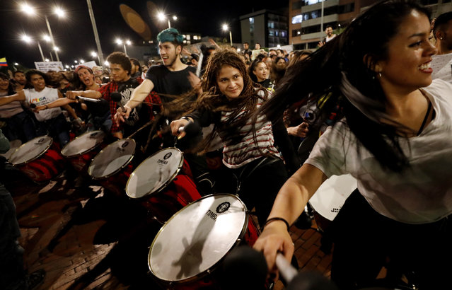 """People play drums during a protest in Bogota, Colombia, 28 November 2019. Under the slogan """"Tambores a las Calles"""" (Drums in the treets), hundreds of percussionists gathered to protest against the government of Colombian President Ivan Duque Marquez. Colombia has recently witnessed a wave of anti-government protests that escalated on 25 November with the death of 18-year-old Dilan Cruz after he was hit by a projectile allegedly fired by police in Bogota. (Photo by Mauricio Duenas Castaneda/EPA/EFE)"""