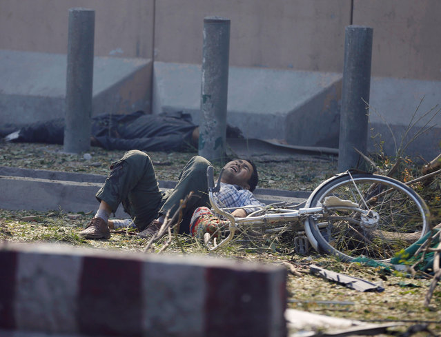 A wounded man lies on the ground at the site of a blast in Kabul, Afghanistan  May 31, 2017. (Photo by Omar Sobhani/Reuters)